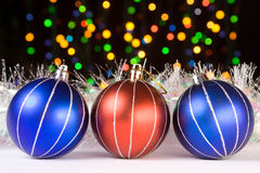 Christmas decorations. Christmas baubles and defocused lights background Stock Photo