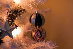 Christmas decorations. A close up shot of a bauble hanging from a christmas tree stock photos