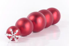 Christmas decorations. Red Christmas balls over white Stock Photography