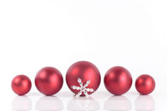 Christmas decorations. Red Christmas balls over white Royalty Free Stock Images