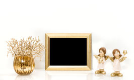 Christmas decorations Angel and Golden frame. Mock up Royalty Free Stock Images