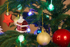 Christmas decorations on artificial fir tree Royalty Free Stock Image