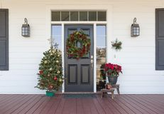Free Christmas Decorations At Front Door Of House Stock Image - 154123141
