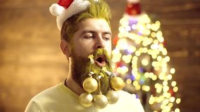 Christmas decorations. Attractive bearded hipster. Beard with Christmas decoration. Merry Christmas and happy New year stock footage