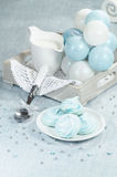 Christmas decorations, azure homemade meringue cookies and cup of milk Royalty Free Stock Photography