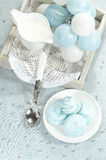 Christmas decorations, azure homemade meringue cookies and cup of milk Stock Image