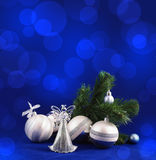 Christmas decorations background. Silver Christmas balls and angel on blue background with copy space for your text Stock Photos