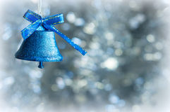 Christmas decorations on a background of shiny tinsel Stock Image