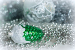 Christmas decorations on a background of shiny tinsel Stock Photo