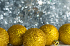 Christmas decorations on a background of shiny tinsel Royalty Free Stock Photography