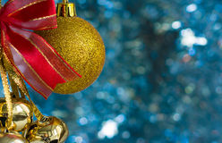 Christmas decorations on a background of shiny tinsel Royalty Free Stock Photos