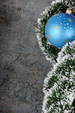 Christmas decorations - ball and spruce tinsel Royalty Free Stock Photos