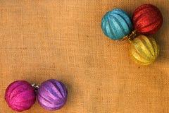 Christmas decorations balls on background sacks.  Stock Photos