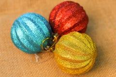 Christmas decorations balls on background sacks.  Royalty Free Stock Image