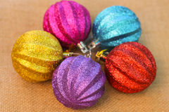 Christmas decorations balls on background sacks.  Royalty Free Stock Photo