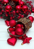 Christmas decorations with balls, basket and ribbon Royalty Free Stock Photography