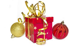 Christmas decorations. Christmas balls and a beautiful box with a gift Royalty Free Stock Image