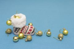 Christmas decorations balls and boots on blue background. Winter holidays concept. Xmas and New year theme Stock Photos