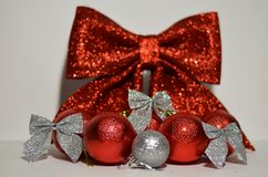 Christmas decorations balls on a bow background. Christmas decorations for christmas tree balls on a bow background Stock Photography