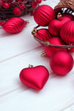 Christmas decorations with balls, brown basket and a ribbon Royalty Free Stock Image