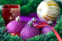 Christmas decorations. Baubles, tape and spruce br Royalty Free Stock Photo