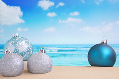 Christmas decorations on the beach, ocean in the back Royalty Free Stock Images