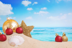 Christmas decorations on the beach, ocean in the back Stock Image