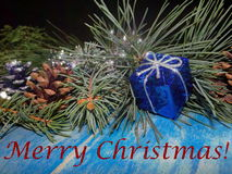 "Christmas decorations. Beautiful Christmas decoration with fir tree branches are on blue wooden boards and the words ""merry Christmas Stock Image"