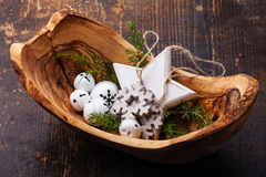 Christmas decorations Bells in olive wood bowl Royalty Free Stock Image