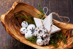 Christmas decorations Bells in olive wood bowl Royalty Free Stock Photo