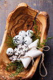 Christmas decorations Bells in olive wood bowl Royalty Free Stock Images