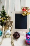Christmas decorations, blackboard and Skeleton got a house Stock Photos