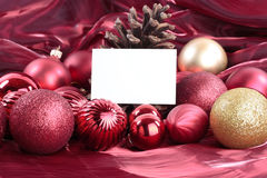 Christmas decorations with blank card Stock Photography