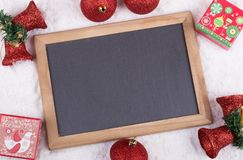 Christmas Decorations and Blank Chalkboard Royalty Free Stock Photos
