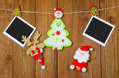 Christmas decorations and blank photo frames on the wooden background. royalty free stock image