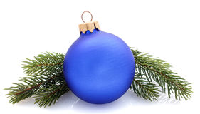 Christmas decorations blue ball and fir branches isolated Royalty Free Stock Photo