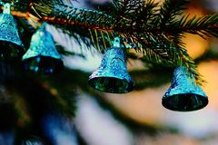 Christmas decorations blue bells. Blue bells on a Christmas tree New Year 2015 royalty free stock images