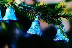 Christmas decorations blue bells. Blue bells on a Christmas tree New Year 2015 stock photo