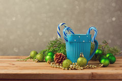 Christmas decorations with blue cup and candy on wooden table with copy space Stock Image