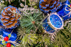 Christmas decorations - blue drum and pinecone Stock Images