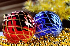Christmas decorations on blurred fir-tree background and light beams Stock Photos