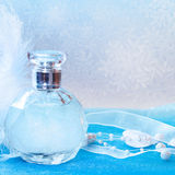 Christmas decorations and bottle of perfume Royalty Free Stock Photography