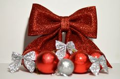 Christmas decorations bow. And balls Royalty Free Stock Photos