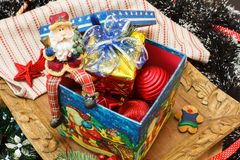Christmas decorations in the box,  gift box and figure Santa Claus  on top Stock Image