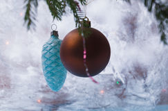Christmas decorations on the branch. The background of the frosted glass. Royalty Free Stock Photo