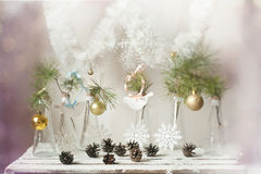 Christmas decorations on a branch of tree in glass vases Stock Photos