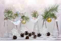 Christmas decorations on a branch of tree in glass vases stock image