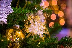 Christmas decorations on the branches of fir tree Royalty Free Stock Images