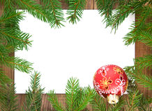 Christmas decorations  and branches of fir-tree Stock Photos