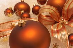 Christmas decorations, brown baubles, composition with bow. Christmas decorations , brown baubles, composition with bow royalty free stock image